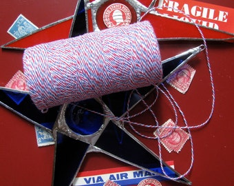 10.99 for 240 yards-one spool of baker's twine. Red White and Blue Airmail Twine.
