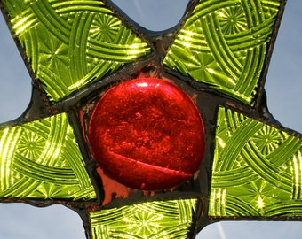 Celtic Christmas stained glass star with lime green patterned glass and red cabochon