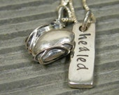 solid sterling bound heart with a hand stamped pendant with word healed and a cross