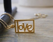 gold love charm cut out word necklace in sterling silver with gold vermeil finish