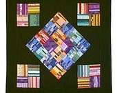 Quilted wall hanging, PATCHWORK collection of colors and dramatic BLACK with RAINBOW quilting.