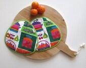 potholders in bright retro kitchen fabric