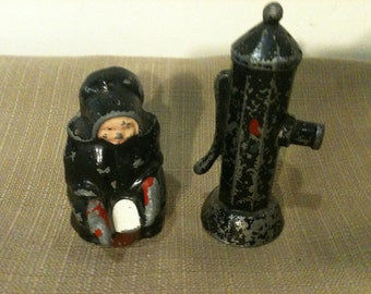 Cast Metal Amish Woman and Water Pump Salt and Pepper Shakers