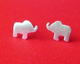Really tiny elephant stud earrings in sterling silver