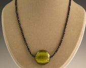 Jet necklace with olive glass foil coin pendant