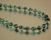 Turquoise and black faceted round necklace