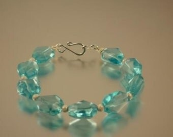 Faceted Aqua Blue Glass and Stardust Bead Bracelet