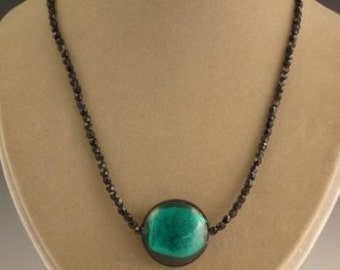 Jet necklace with teal glass foil coin pendant
