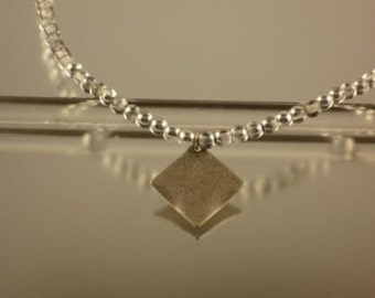Silver Druk Bead Necklace With Antique Silver Wavy Diamond Pendant