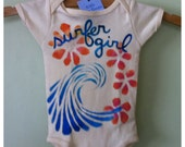 Baby onesie or Childrens tshirt , surfer girl with plumeria and wave hand painted