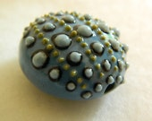 Sea urchin pendant bead in porcelain clay in blues and green