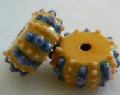 Sea urchin dot and striped porcelain beads in yellow, orange, turquoise and purple