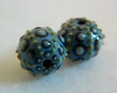 Sea urchin bead in porcelain clay in blues and green, small