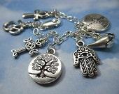 Ancient Religions Charm Bracelet- om, hamsa, tree of life, cross, ankh, labyrinth, genie
