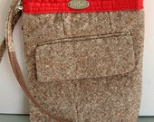 brown and red crossover with zipper closure