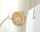 natural crochet fossil amulet necklace - cotton spiral on juniper wood slab - hemp cord - puka shell and silver detail - Joik