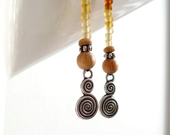 SALE - long spiral pendululum earrings, earthy,  with glass beads & antiqued silver charms - Crop Circle