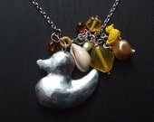 zinc duck necklace with yellow beads