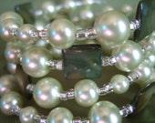 Spring Me Some Green -dark green shell and light green glass pearl beaded bracelet
