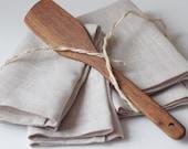 Kitchen set. Linen napkins with kitchen wooden shovel.