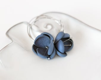 Modern style leather earrings in blue