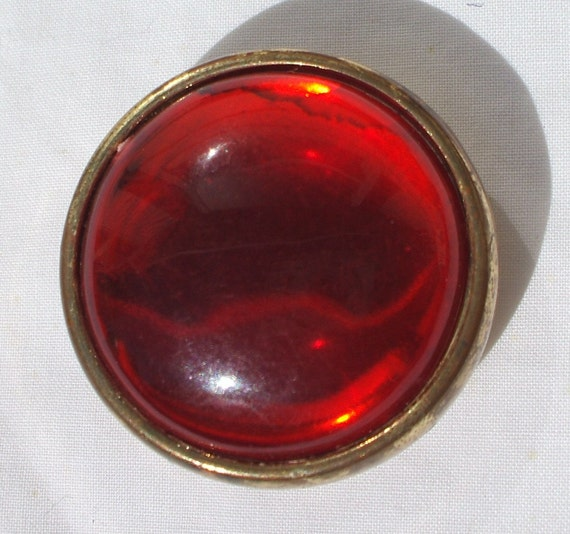 Vintage red button with a moonglow shine to it