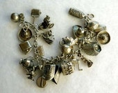 Sterling Silver Charm Bracelet - 24 Unique Sterling Charms on Chain