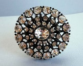Round Rhinestone Vintage Brooch with Clear Rhinestones in Black Japanned Setting
