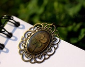 Where Nature Collides with Steampunk - Four leaf clover Victorian style necklace