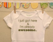 I just got here & I'm already awesome.  --- white onesie, size 0-3 months.
