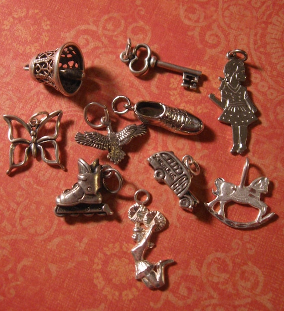 SET OF TEN VINTAGE STERLING SILVER CHARMS