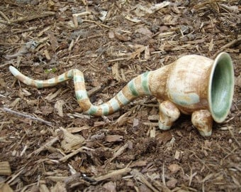 Curly Creature - ceramic art, brown with green stripes - Curly Creature 2
