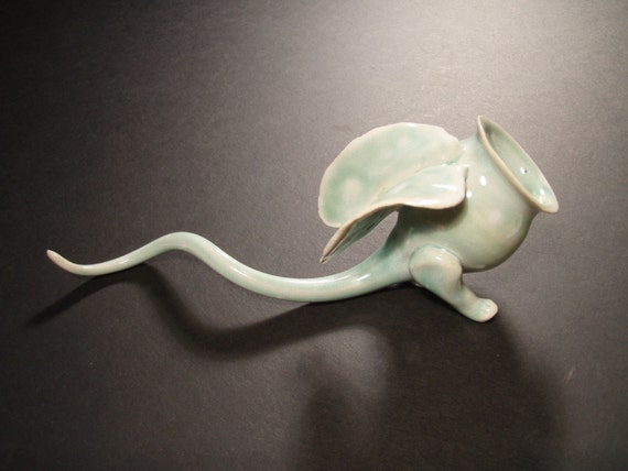 Curly Creature - ceramic art, blue-green and white - two-legged winged flier