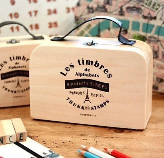 64 Rubber stamps set in a wooden box- alphabets