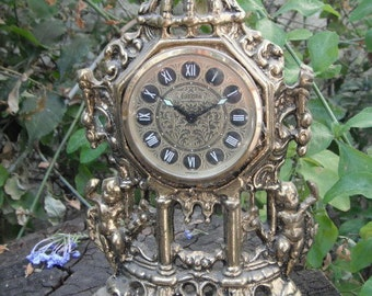 Sale----Was 45usd NOW only 38usd -----Vinatge clock Europa ornate cherubs Barroc style Germany 2 Jewels