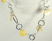 Yellow mother-of-pearl shell necklace on chunky silver chain