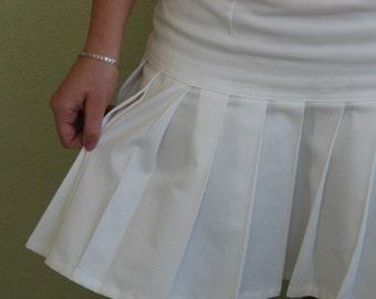 Stylish many pleated white skirt