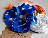 rosette hair clip in orange and navy blue with gold enamel bow and fluff feathers