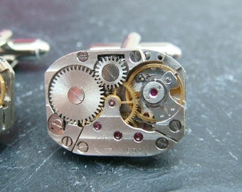 Cufflinks with rare striped Russian watch movements