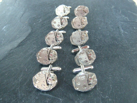 5 Matching sets of Watch Movement Cufflinks ideal cufflinks for a wedding.