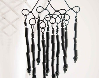 BLACK DAZZLE: Chandelier earrings, all black