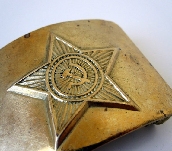 USSR Army belt buckle with star, hammer, sickle design. Authentic accessory from Soviet Union