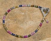 Tourmaline, sapphire, kyanite with bali silver bracelet