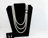 Cream pearl three strand necklace and earring set