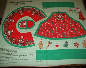 An Adorable Gingerbread Bake Shop Holiday Child Apron Fabric Panel Free US Shipping