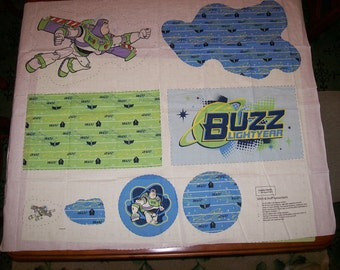 An Adorable Stitch and Stuff Buzz Lightyear Toy Story Fabric Panel Free US Shipping