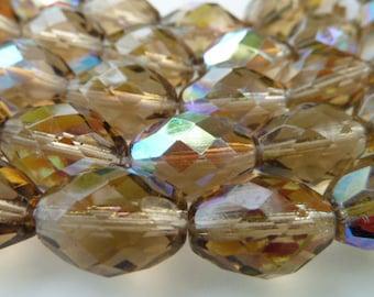 12 Czech Glass Oval Fire Polish Glass Beads in Transparent Smokey Topaz AB  in size 11x15mmmm