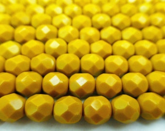 50 Czech Glass Fire Polish Beads  in  a  Opaque Mustard in size 6mm Round