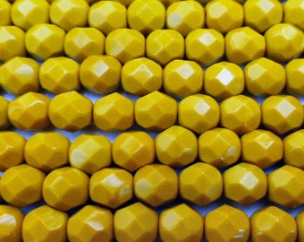 100 Czech Glass Fire Polish Beads  in  a  Opaque Mustard in size 6mm Round