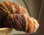 LEA handdyed and hanspun romnay, english whool, yello and red glitz and green neps 234 yards